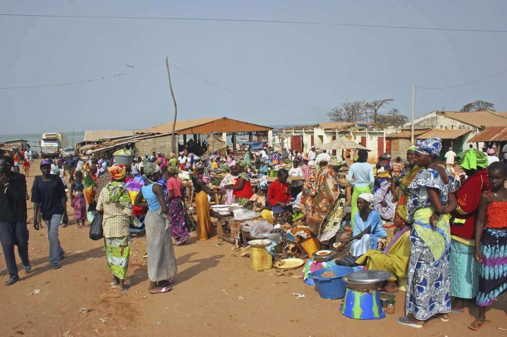 Stock Photo: 1850-25235 Gambia, Western Gambia , Tanji, Tanji Market.  Busy Market Scene With Line Of Food Stalls And Crowds Of People In Brightly Coloured Dress.