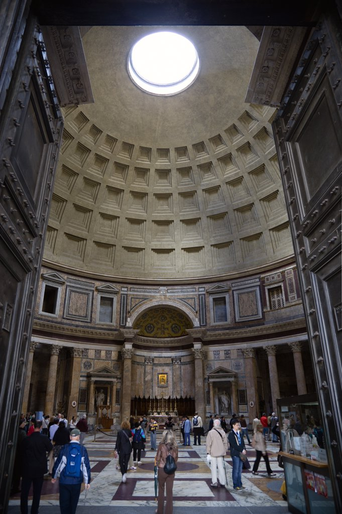 Italy, Lazio, Rome, The Interior Of The Pantheon Showing The Oculus Central Opening And The Coffering Construction Of The Dome With Tourists Walking On The Patterned Marble Flooring : Stock Photo
