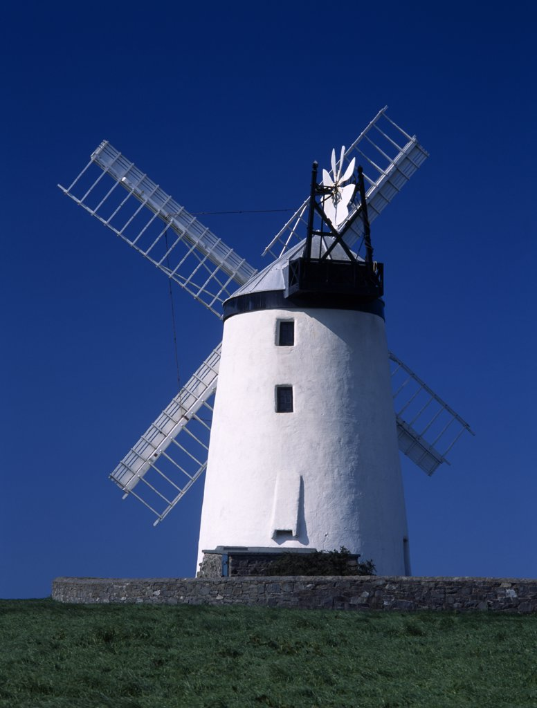 Stock Photo: 1850-26035 Ireland, North, County Down, 'Ballycopeland Windmill.  White Painted Windmill Standing Against Blue, Cloudless Sky.'