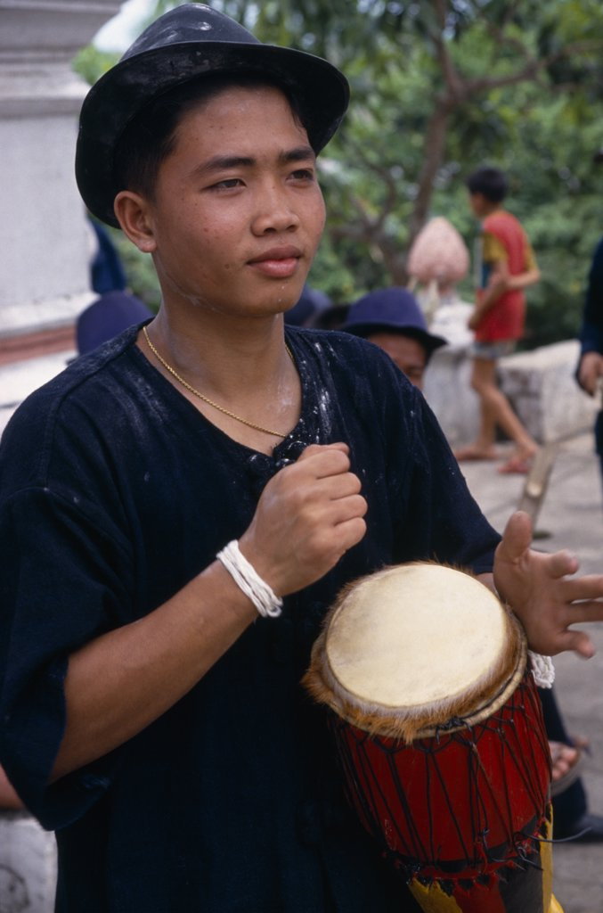 Stock Photo: 1850-26257 Laos, Luang Phrabang, Portrait Of Drummer Celebrating The Lunar New Year.