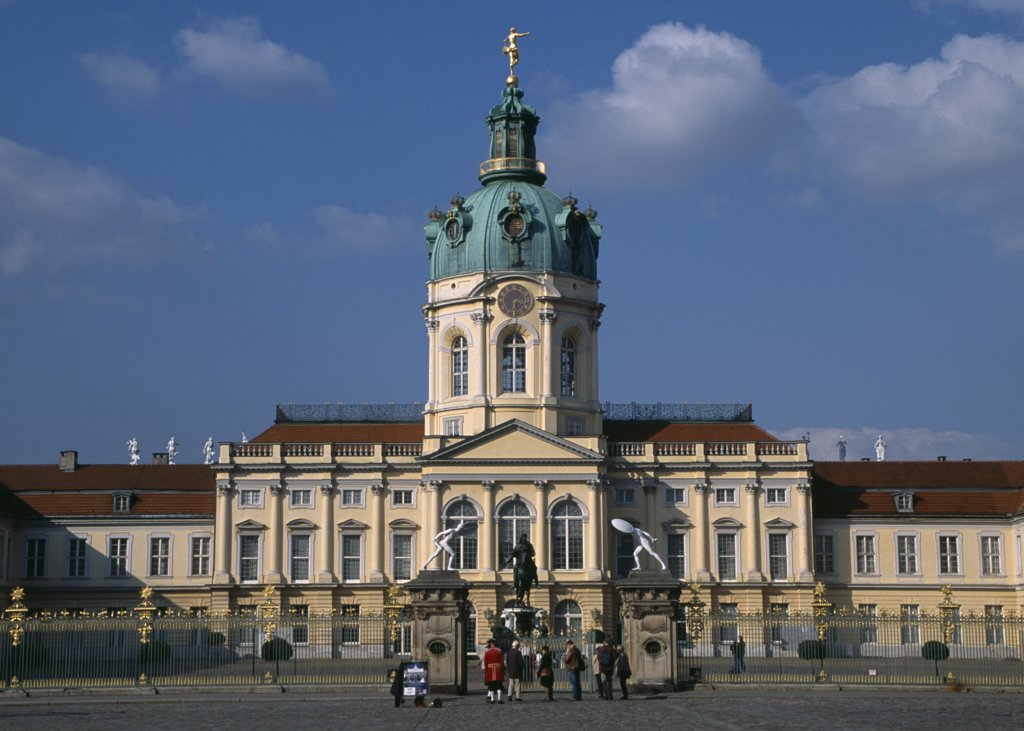 Stock Photo: 1850-26748 Germany, Berlin, Charlottenburg Palace.  Exterior Facade Of Eighteenth Century Baroque Palace With Visitors Outside Ironwork Gates.
