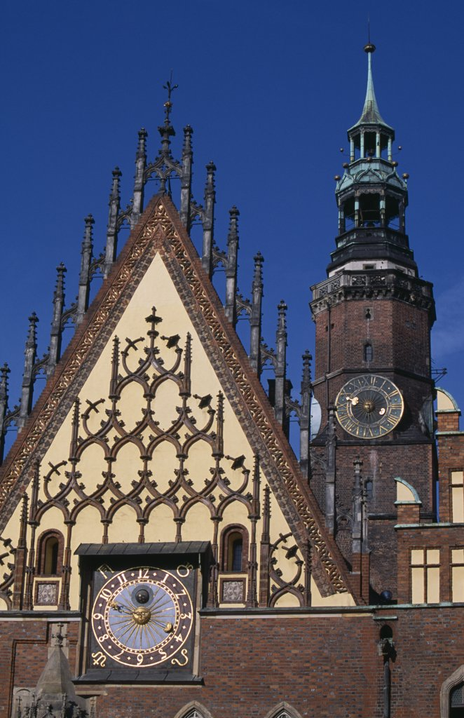 Poland, Wroclaw, Wroclaw Town Hall Dating From The Fourteenth Century.  Part View Of Exterior With Decorative Gable  Astronomical Clock And Clock Tower. : Stock Photo