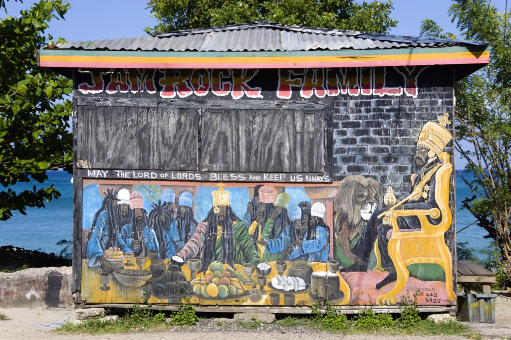 Stock Photo: 1850-26819 West Indies, Grenada, Carriacou, Colourful Rastafarian Food Hut Called Jam Rock Cafe On The Beach In Hillsborough Decorated With A Rastafarian Last Supper And Emperor Haile Selassie Painted On It And The Words May The Lord Of Lords Bless And Keep Us Always