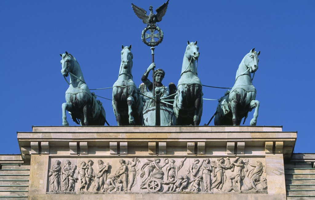 Stock Photo: 1850-27143 Germany, Berlin, 'The Brandenburg Gate.  The Quadriga On Top Of The Gate.  Chariot Drawn By Four Horses Driven By Victoria, Roman Goddess Of Victory.'