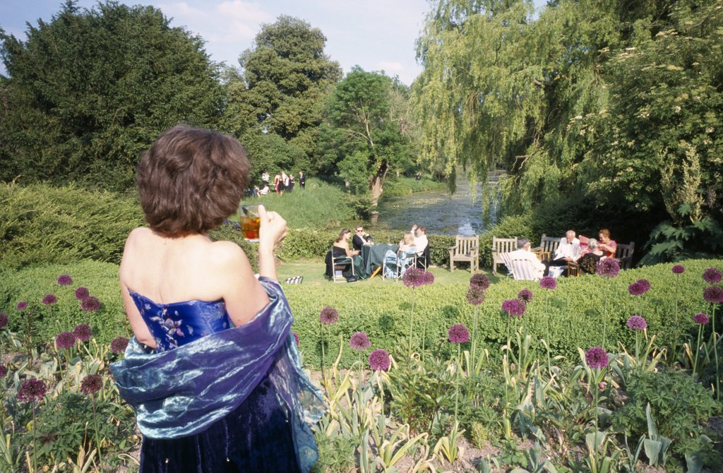England, East Sussex, Glyndebourne, Opera Attendees Enjoying Picnics In The Gardens During Interval. : Stock Photo