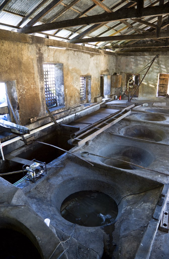 Stock Photo: 1850-27395 West Indies, Grenada, St Patrick, The Ancient Copper Vats For Boiling The Sugarcane Juice At The River Antoine Rum Distillery.