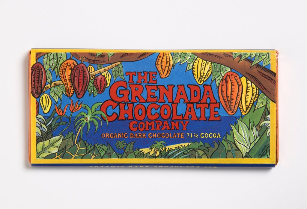 Stock Photo: 1850-27422 West Indies, Grenada, St Patrick, Bar Of 71% Percent Cocoa Organic Dark Chocolate Form The Grenada Chocolate Company In Colourful Wrapper.