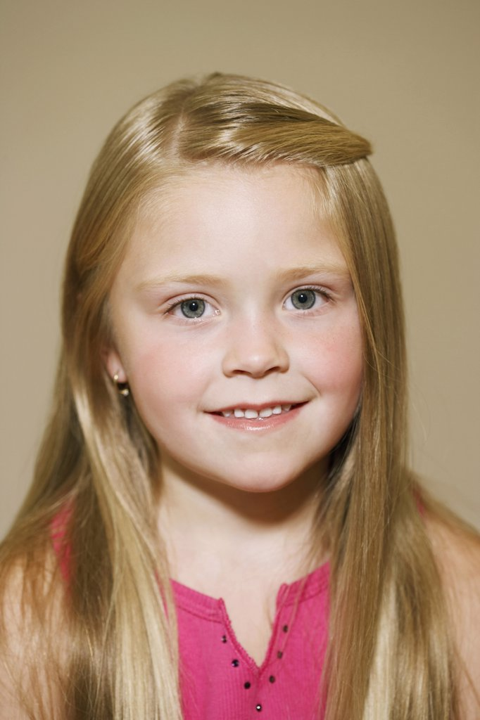 Stock Photo: 1850-27947 People, Children, Girls, Portrait Of 7 Year Old Girl Smiling.