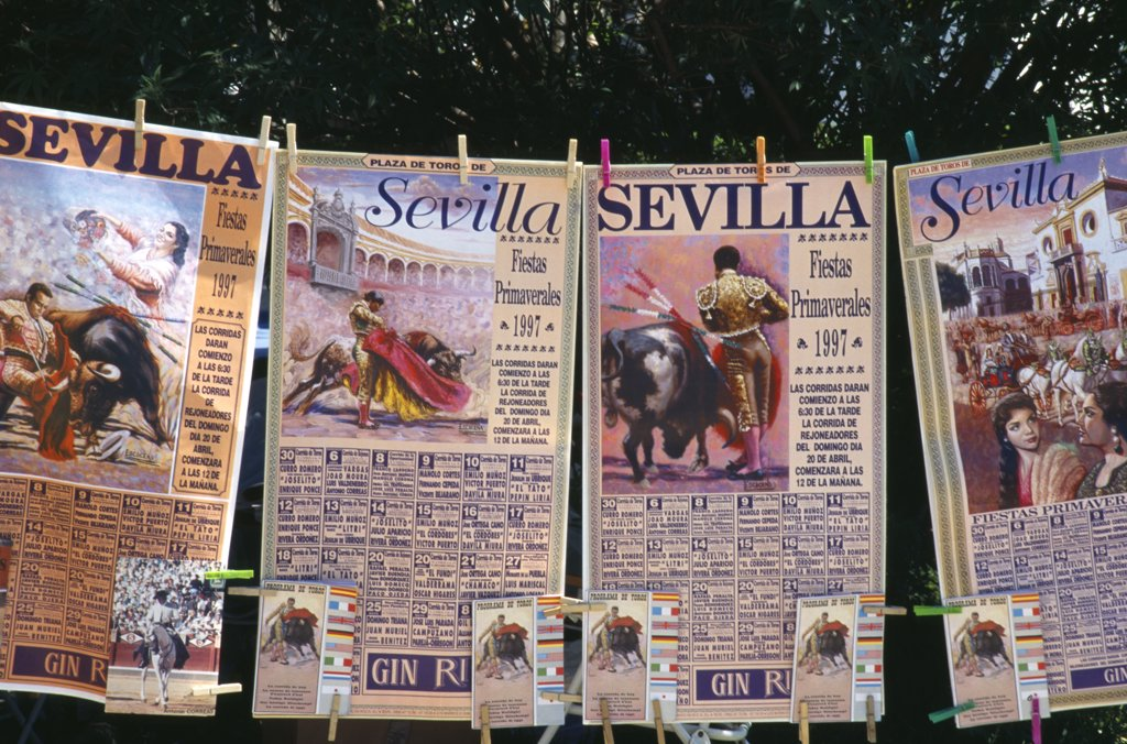 Stock Photo: 1850-28330 Spain, Andalucia, Seville, Posters And Tickets For A Bullfight Hanging From A Line Outside The Bullring In Arenal District.