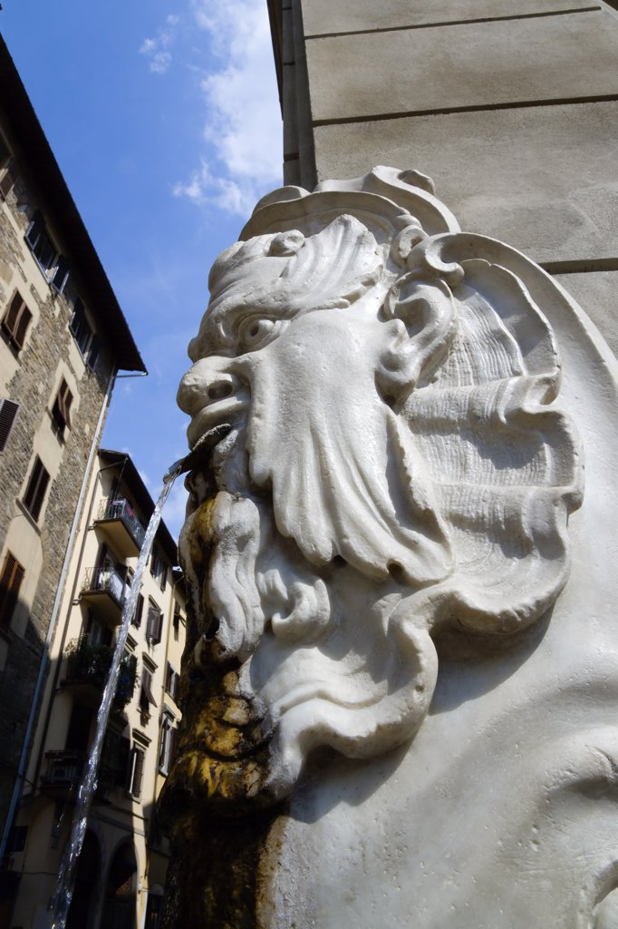 Stock Photo: 1850-29120 Italy, Tuscany, Florence, Santa Croce District Drinking Water Fountain In The Form Of A Male Head On The Corner Of A Street.