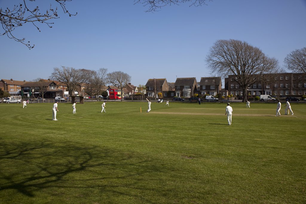 England, West Sussex, Southwick, Local Cricket Team Playing On Village Green. : Stock Photo