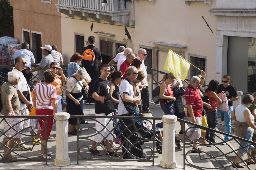 Stock Photo: 1850-30636 Italy Veneto Venice, Tour group of tourists crossing bridge