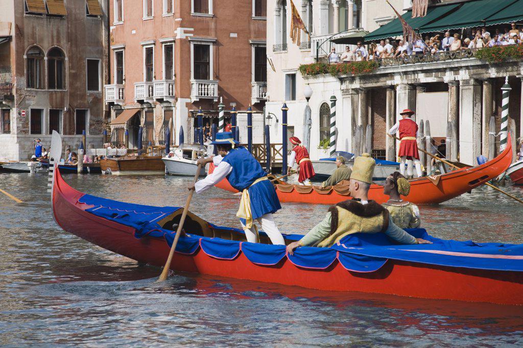 Italy Veneto Venice, Participants in the Regatta Storico historical annual regatta wearing traditional costume rowing : Stock Photo