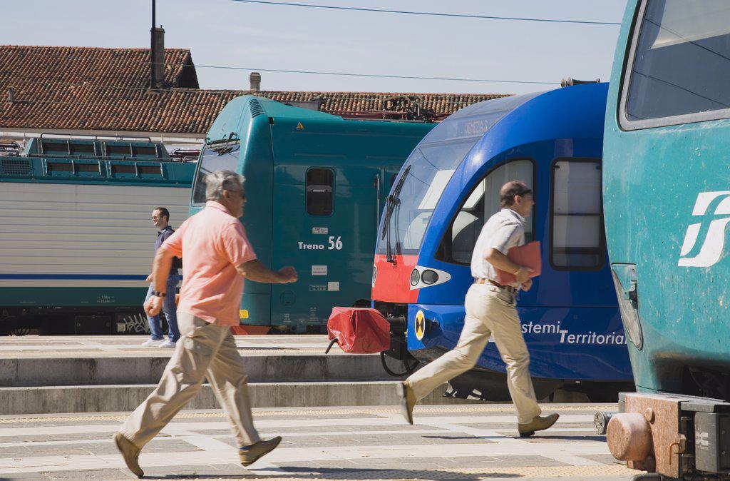 Italy Veneto Venice, Commuters running to board local train : Stock Photo