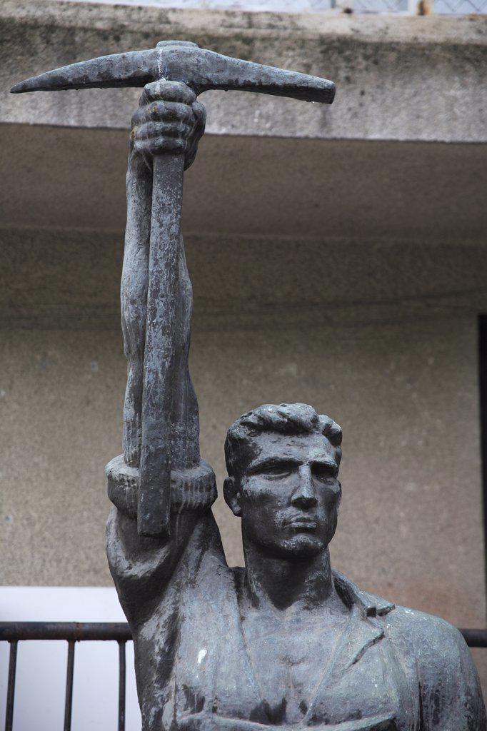 Albania Tirana, Statue of communist worker holding pickaxe : Stock Photo