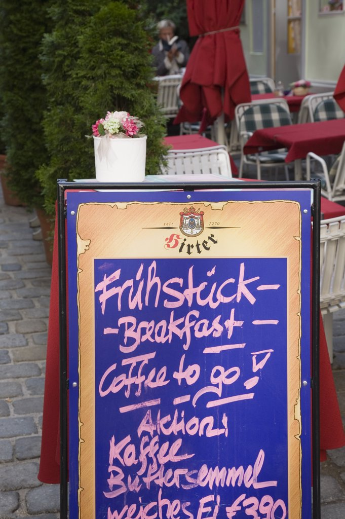 Stock Photo: 1850-31532 Austria Vienna, A board sign outside courtyard cafe advertising breakfast menu