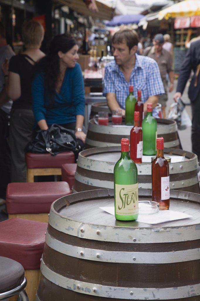 Austria Vienna, Young couple having glass of Federweisser  wine : Stock Photo