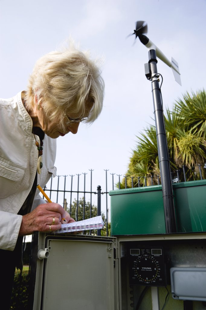 Climate, Weather, Measurements, Weather observer taking readings from the wind speed direction monitor at Bognor Regis weather station. : Stock Photo