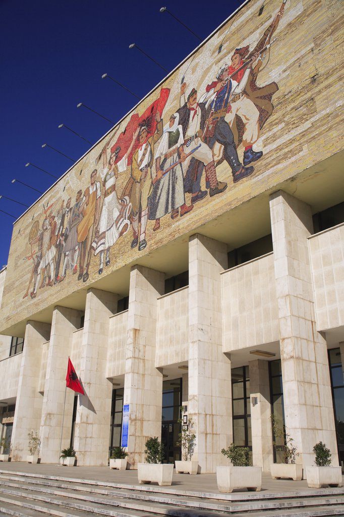 Albania, Tirane, Tirana, National History Museum. Mosaic on the exterior facade of the National History Museum in Skanderbeg Square with steps to entrance below. : Stock Photo