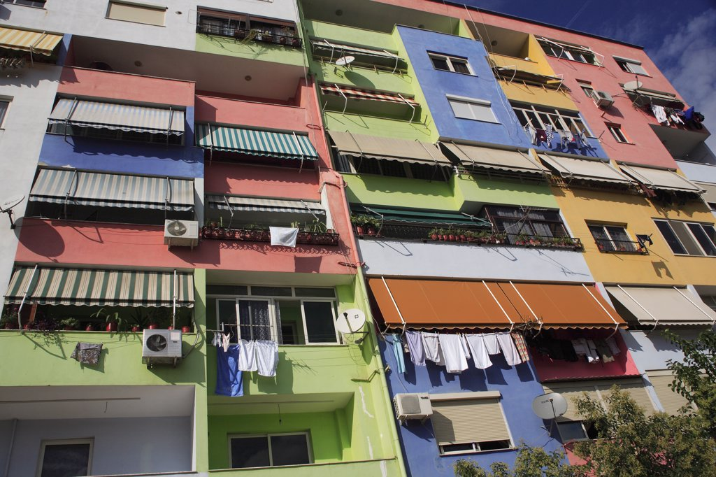 Albania, Tirane, Tirana, Multi coloured exterior facade of apartment block. : Stock Photo