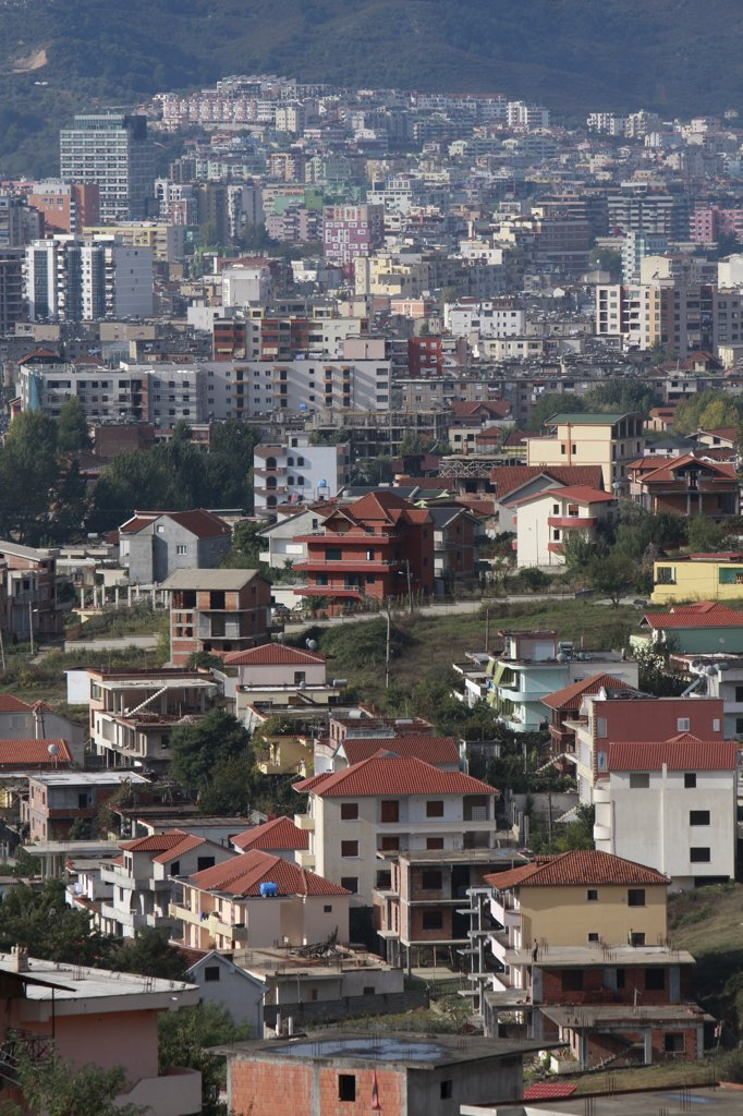 Albania, Tirane, Tirana, View across residential buildings to the hillside beyond. : Stock Photo