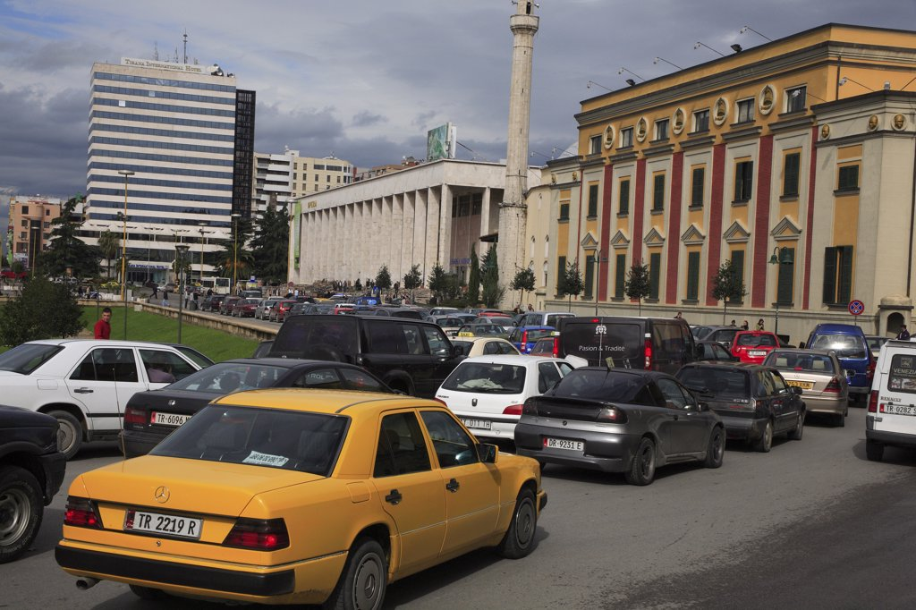 Stock Photo: 1850-31987 Albania, Tirane, Tirana, Congested traffic in front of the Opera House  Ethem Bey Mosque and government buildings on Skanderbeg Square.