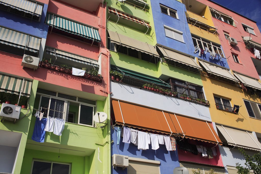 Albania, Tirane, Tirana, Multi coloured exterior facade of apartment block. : Stock Photo