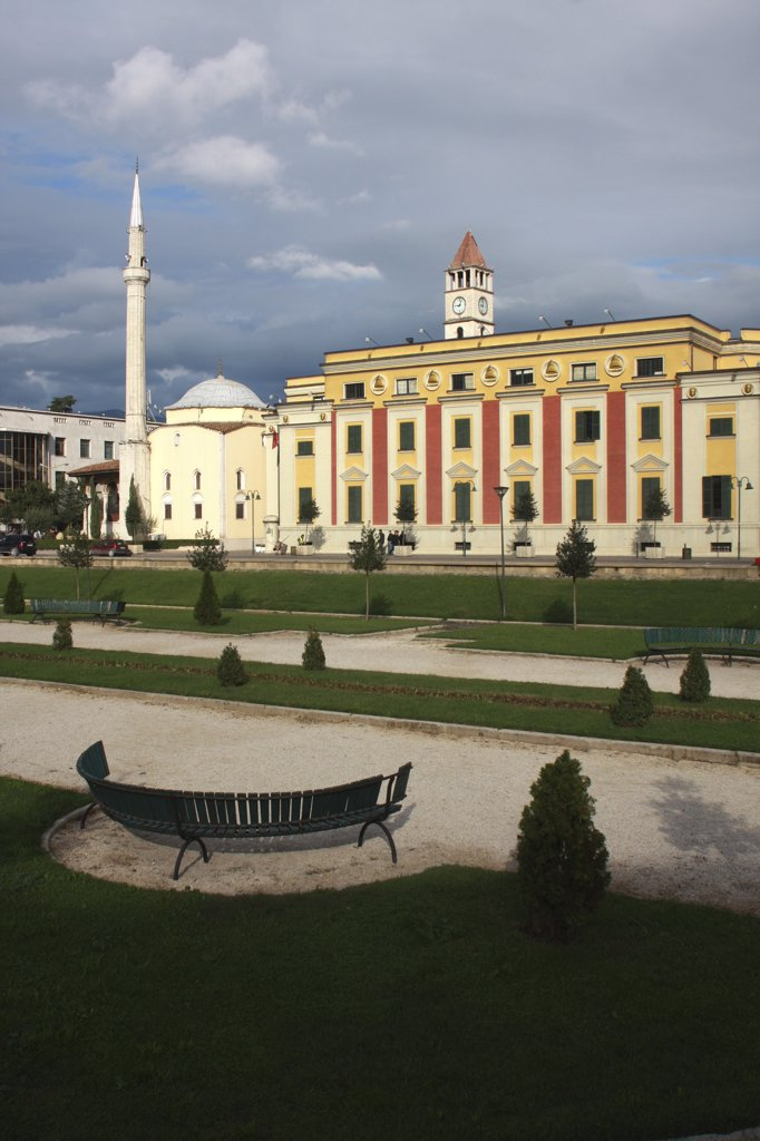 Stock Photo: 1850-32016 Albania, Tirane, Tirana, Government Buildings and Ethem Bey Mosque on Skanderbeg Square with formal gardens in foreground.