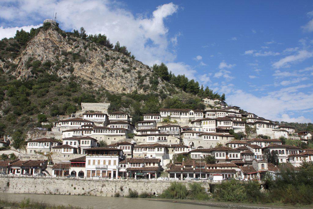 Stock Photo: 1850-32020 Albania, Berat, Ottoman houses at foot of steep hillside.