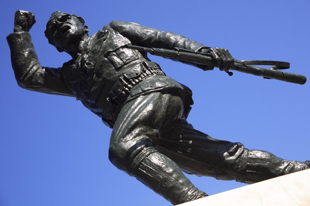 Stock Photo: 1850-32184 Albania, Tirane, Tirana, Statue of the Unknown Partisan  from low angle looking upwards  against blue sky.