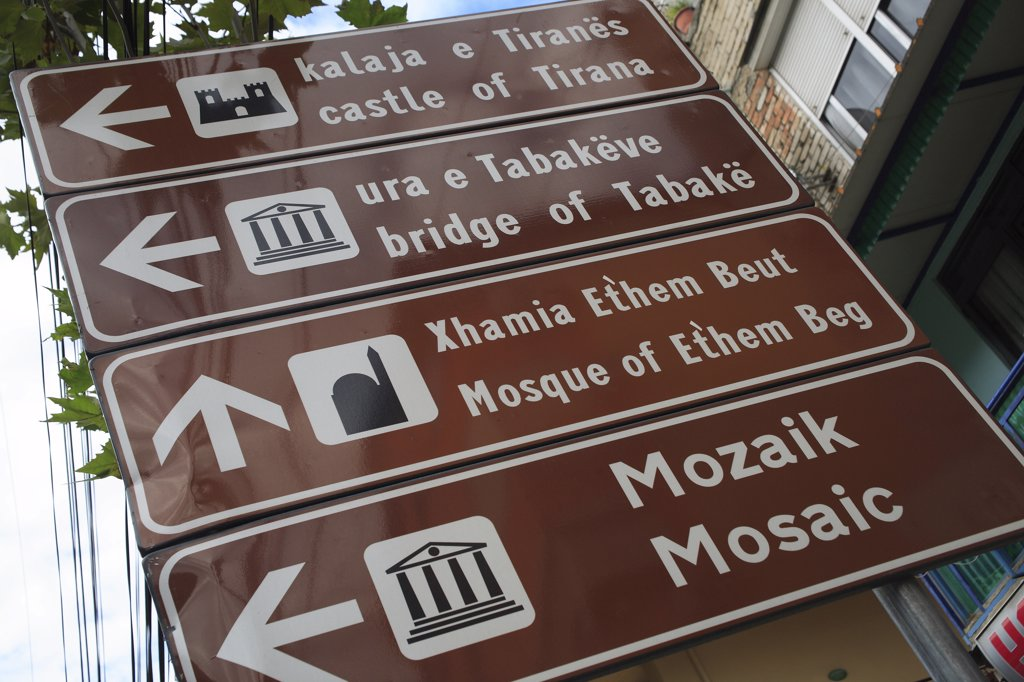 Albania, Tirane, Tirana, Street sign giving directions for places of interest in the city. : Stock Photo