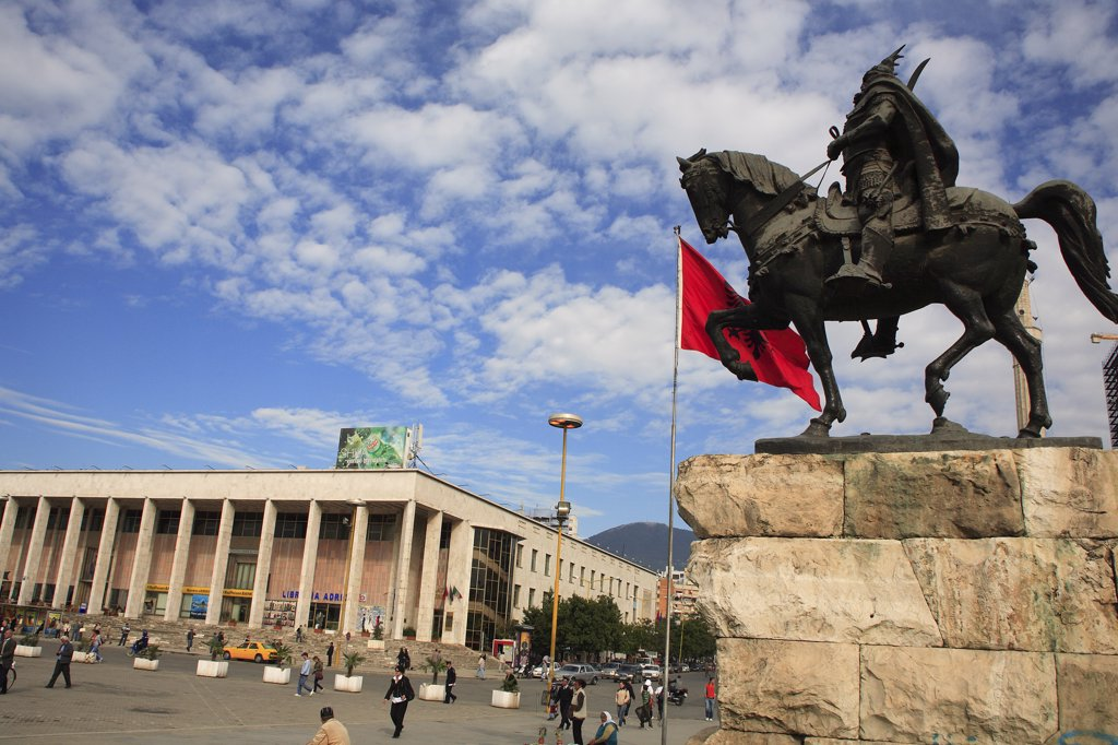 Stock Photo: 1850-32408 Albania, Tirane, Tirana, Equestrian statue of national hero George Castriot Skanderbeg in busy Skanderbeg Square with the Opera House in the background.