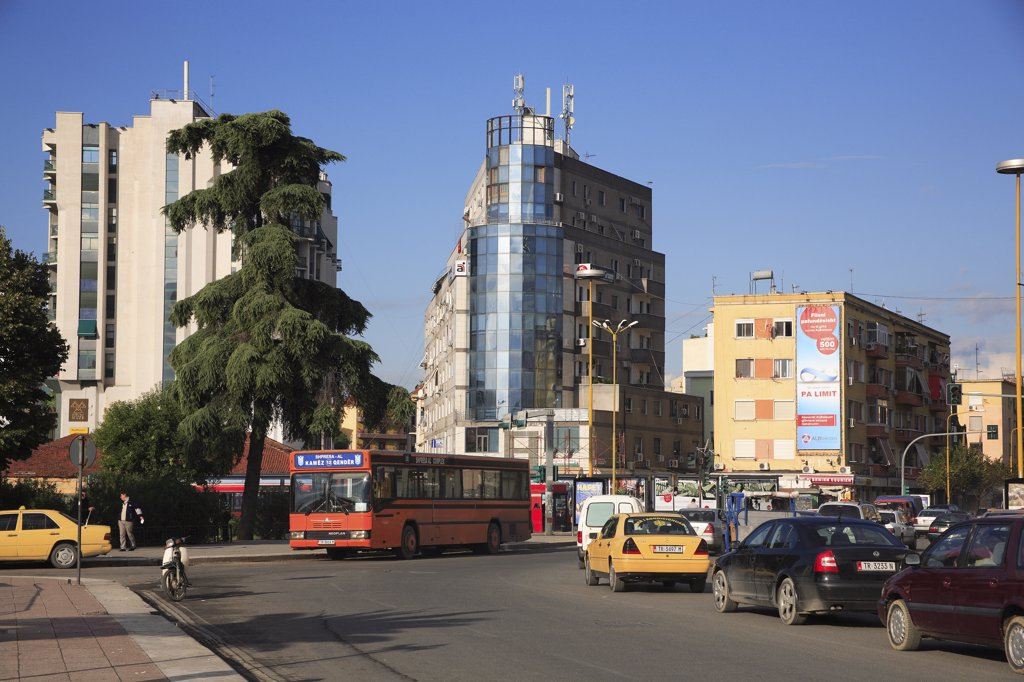 Albania, Tirane, Tirana, Busy street scene with bus in traffc. : Stock Photo