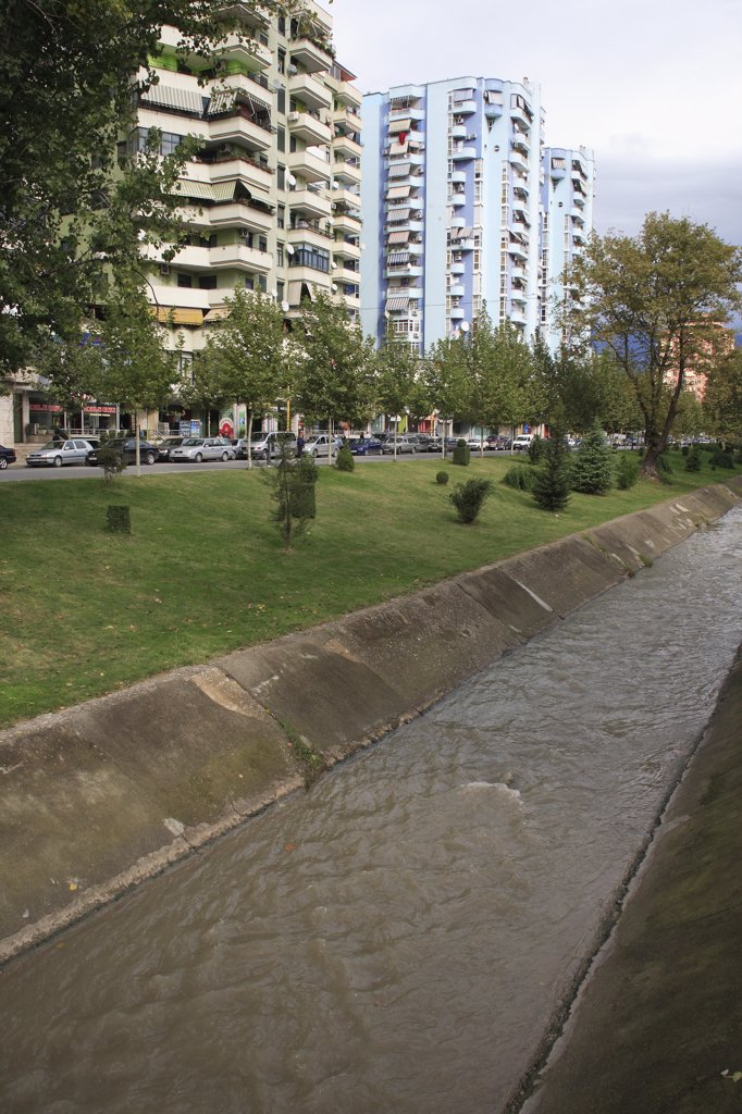 Stock Photo: 1850-32428 Albania, Tirane, Tirana, River Lana running past apartment blocks.
