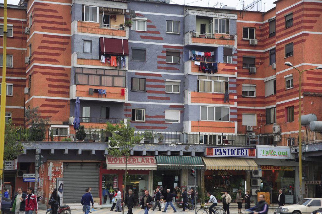 Albania, Tirane, Tirana, Colourful apartment buildings with shops below. : Stock Photo