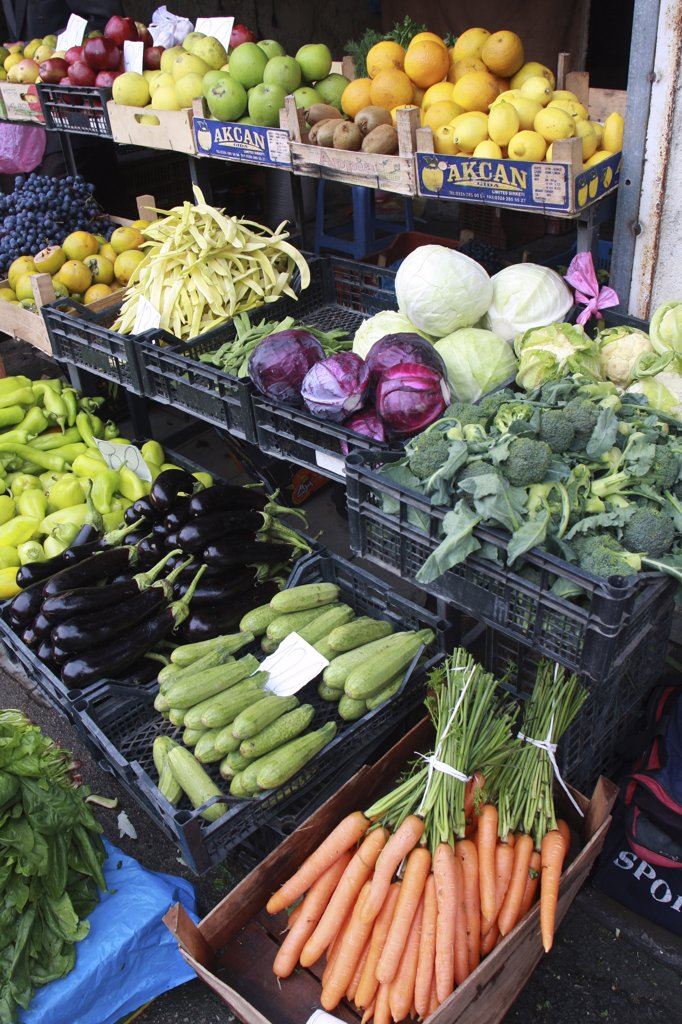 Stock Photo: 1850-32444 Albania, Tirane, Tirana, Display of fruit and vegetables including aubergines  carrots and cabbage at grocers in the Avni Rustemi market.