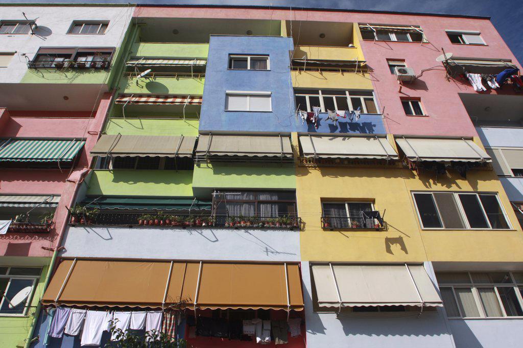 Albania, Tirane, Tirana, Part view of exterior facade of multi coloured apartment block. : Stock Photo