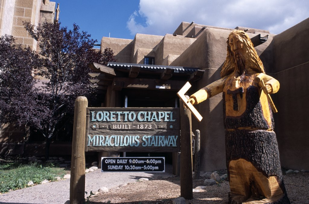 USA, New Mexico, Santa Fe, Wood carving at the entrance to the Loretto Chapel, built 1873. : Stock Photo