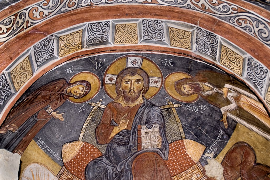 Turkey, Cappadocia, Goreme, Goreme Open Air Museum, The Dark Church, So named because it had very few windows. The frescoes date from the 11th century. Dark Church is known in Turkish as Karanlik Kilise, Christ as Pantocrator. : Stock Photo