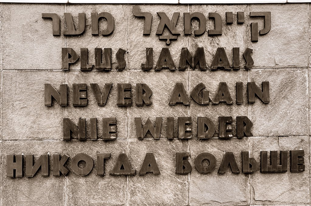 Stock Photo: 1850-32845 Germany, Bavaria, Munich, Dachau World War II Nazi Concentration Camp, A hopeful wish for the future written in Hebrew, French, English, German and Russian.
