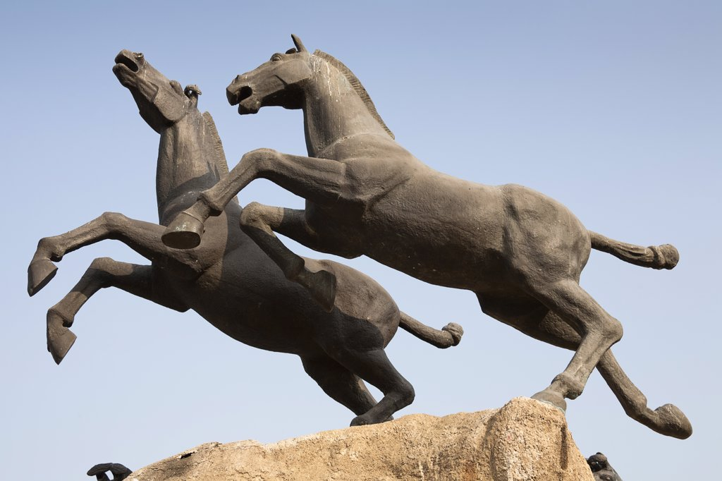 Stock Photo: 1850-32927 China, Shaanxi Province, Xian, Statue of two galloping horses.