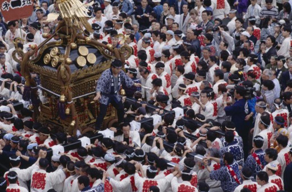 Japan, Honshu, Tokyo, Men Carrying Mikoshi Shrine Through The Street During A Festival : Stock Photo