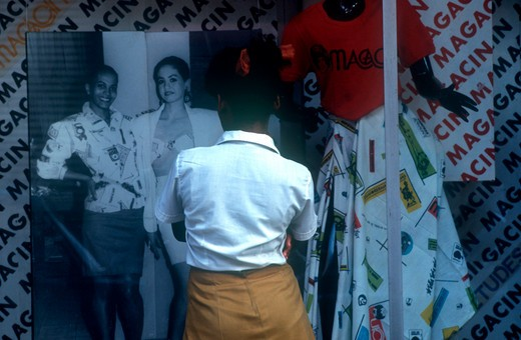 Stock Photo: 1850-4159 Cuba,  , Havana, School Girl Standing At Fashion Shop Window