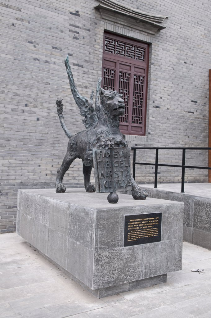 Stock Photo: 1850-44219 China, Jiangsu, Yangzhou, Bronze lion sculpture outside the Marco Polo Museum. The sculpture is a copy of the lion statue standing in a square in Venice the hometown of Marco Polo. Marco Polo served as a municipal official of Yangzhou from 1282-1287 during the reign of the Mongol emporor Kubilai Khan.