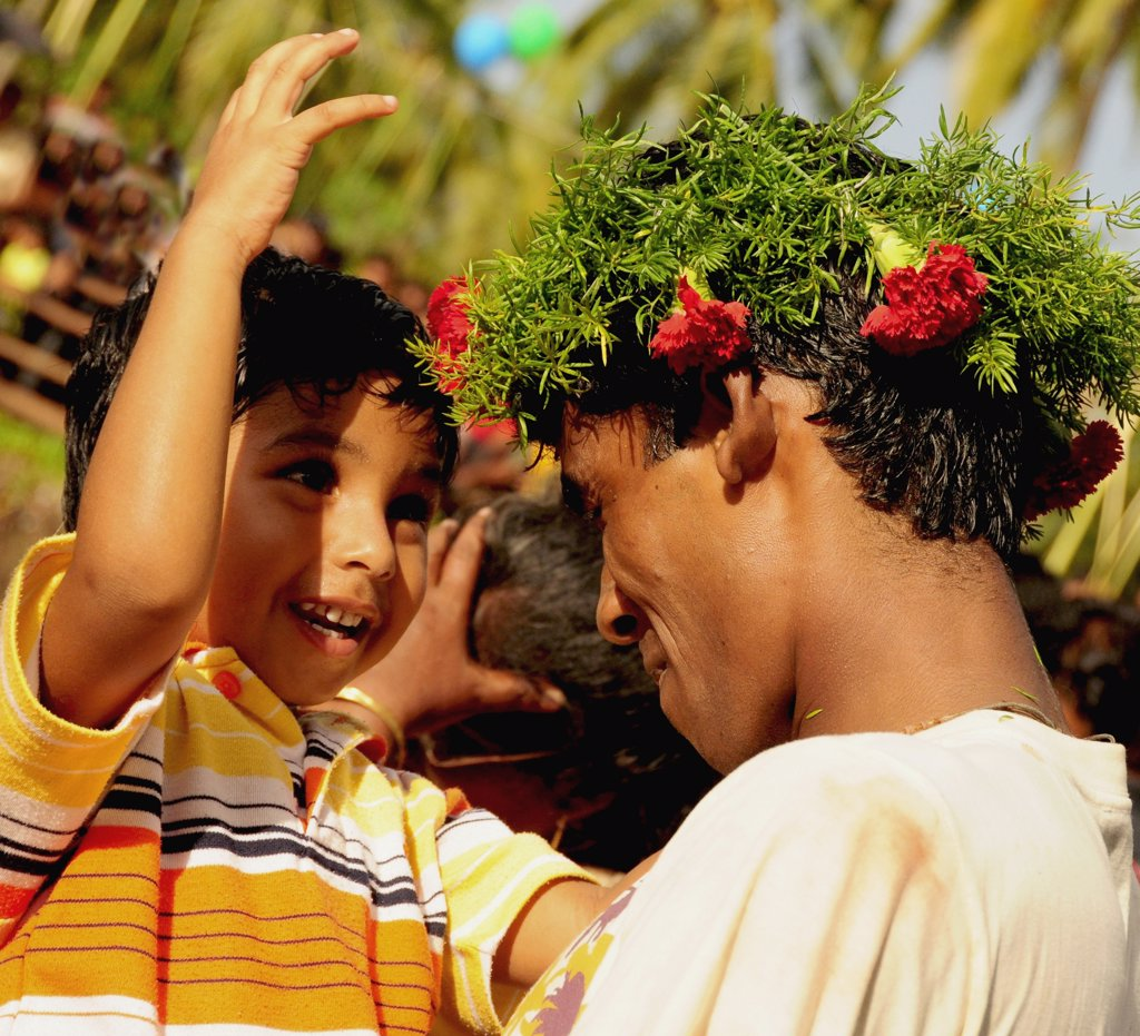 India, Goa, Siolim,  San Jao Festival celebrated with flower head wreaths. : Stock Photo