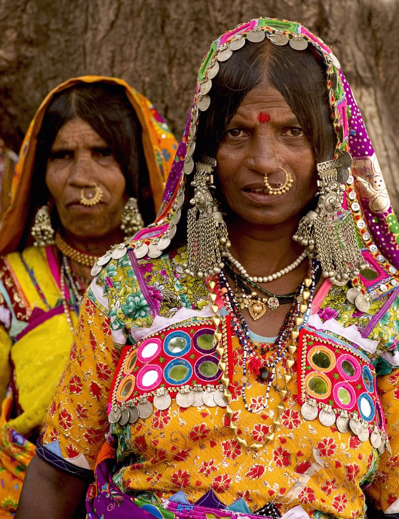 India, Karnataka, People, Lambani Gypsy women wearing gold nose rings. Tribal forest dwellers now settled in 30-home rural hamlets. Related to the Rabaris gypsies of Kutch Gujarat. : Stock Photo