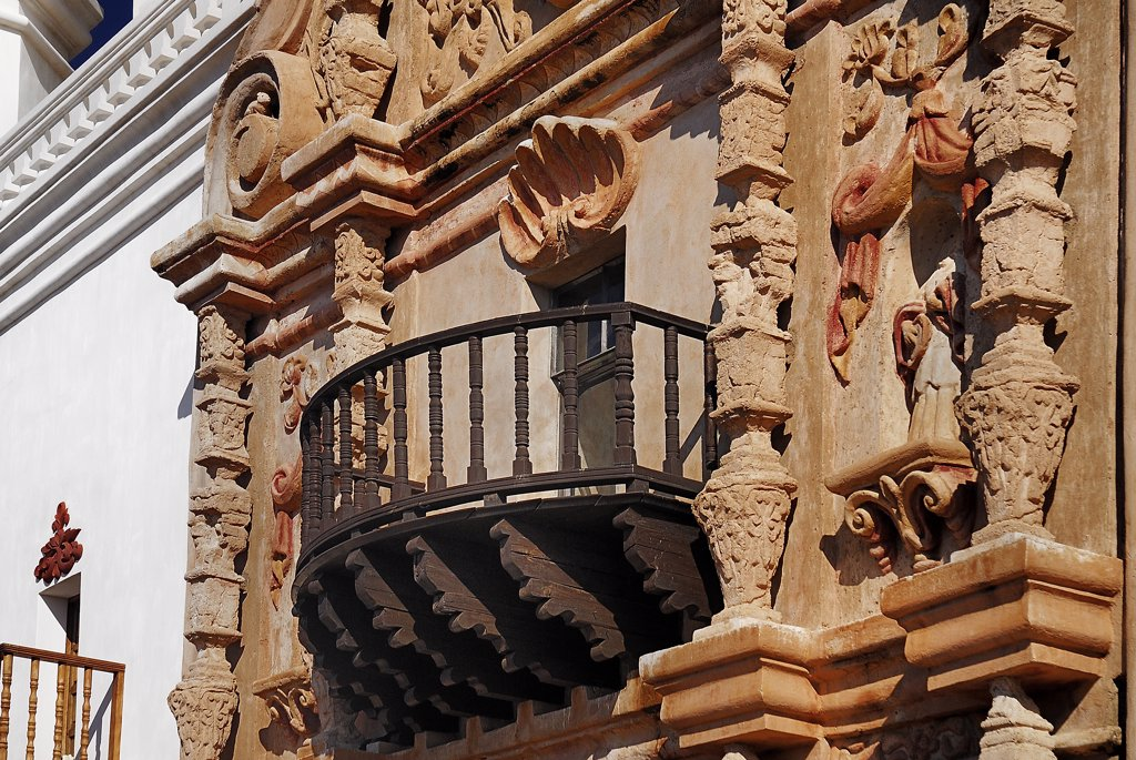 Stock Photo: 1850-45049 Mission Church of San Xavier del Bac. Detail of balcony and carved window surround.USA Arizona Tucson