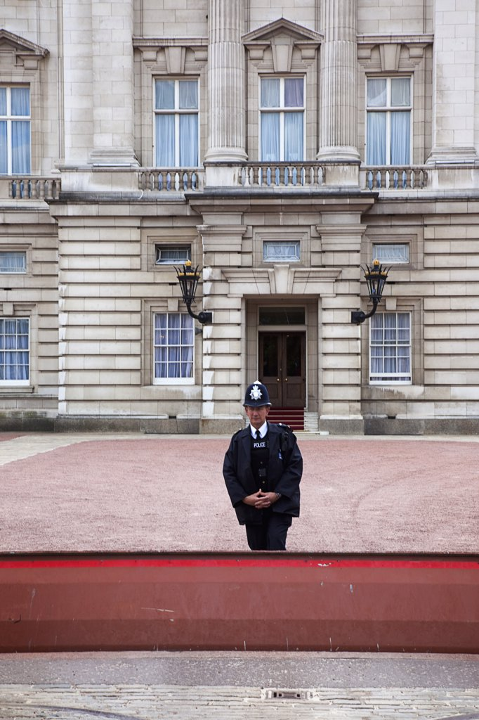 Stock Photo: 1850-45312 Westminster Buckingham Palace exterior with Police guard at the entrance.England London