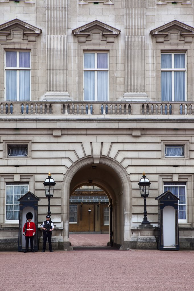 Stock Photo: 1850-45313 Westminster Buckingham Palace exterior with both Queens Guard and Metropolitan Police armed officers, England London