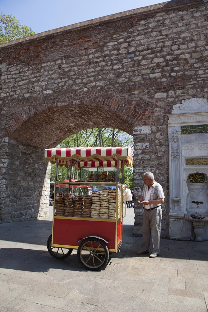 Stock Photo: 1850-45375 Sultanahmet bread snack vendor at the entrance to Topkapi Palace Gardens.Turkey Istanbul